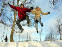 Jumping couple. winter. Stock Image
