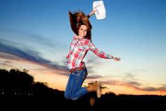 Jumping Cowgirl Stock Photography