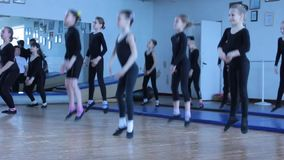 Jumping dance exercise dance. Training choreographic group of children in the gym children's folk group Circus Ale-up. Kiev vdorets children and youth. Kiev stock footage