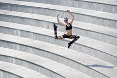 Jumping dancer in arena Royalty Free Stock Photo