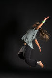 Jumping dancer on black bacground Stock Images