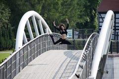 Jumping dancer on bridge Royalty Free Stock Photo