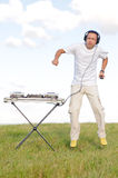 Jumping disc jockey on meadow Royalty Free Stock Photography