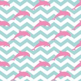 Jumping dolphins. Seamless nautical pattern with silhouettes of dolphins. Zig zag background royalty free illustration