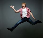 Jumping dude. Happy dude jumping and waving hand royalty free stock photography