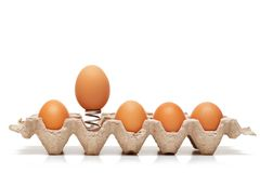 Jumping egg. One egg is jumping from container Royalty Free Stock Image