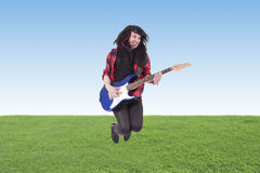 Jumping with electric guitar Royalty Free Stock Images