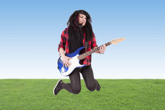Jumping with electric guitar Royalty Free Stock Image