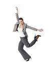 Jumping elegant woman smiling stock photo