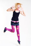 Jumping emo girl. In pink lacerated stockings stock image