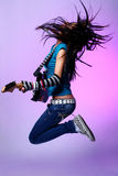 Jumping emo girl. Emo girl with electro guitar stock photos