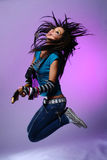 Jumping emo girl with guitar. Jumping emo girl with electro guitar stock photo