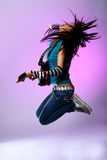 Jumping emo girl with guitar. Jumping emo girl with electro guitar royalty free stock image