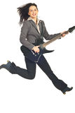 Jumping executive woman with guitar Royalty Free Stock Photo