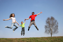 Jumping family. spring. Tree Royalty Free Stock Photos