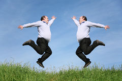 Jumping fat twins on grass collage Stock Photo