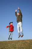 Jumping father with son royalty free stock photos