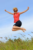 Jumping female Stock Images