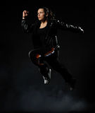 Jumping female dancer Stock Photos