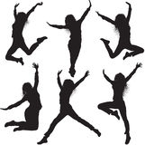 Jumping female silhouettes Stock Photo