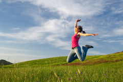 Jumping on the field Royalty Free Stock Photo