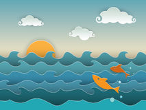Jumping fish in the deep blue sea. Jumping golden fish in the deep blue sea. A seascape with the setting sun, fluffy clouds and jumping fish. Cut paper style Stock Photo