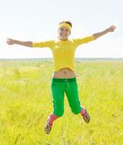 Jumping fit girl Stock Images
