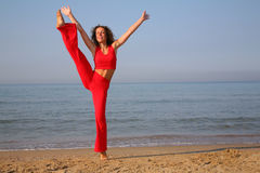 Jumping fitness woman on beach. Summer Stock Images