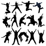 Jumping and flying people silhouettes Royalty Free Stock Photography