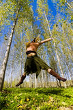 Jumping in the forest Royalty Free Stock Photo