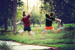 Jumping in the forrest. Two teenagers are jumping and playing  in a forrest in Houston, Texas Royalty Free Stock Photo