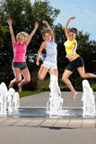 Jumping in a fountain Stock Photo