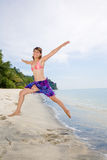 Jumping freely at the beach Stock Photography