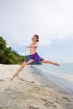 Jumping freely at the beach Royalty Free Stock Photos