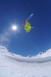 Jumping freestyle skier. In the mountains Stock Image