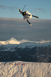 Jumping freestyle skier. In the air. Extreme sports athlete jumping in the mountains Royalty Free Stock Images