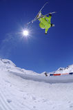 Jumping freestyle skier. In the air. Extreme sports athlete jumping in the mountains Royalty Free Stock Photos