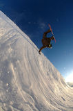 Jumping freestyle snowboarder Stock Photo