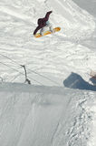 Jumping freestyle snowboarder Stock Image
