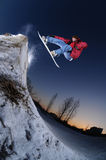 Jumping freestyle snowboarder Royalty Free Stock Photo