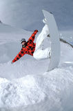 Jumping freestyle snowboarder Royalty Free Stock Image