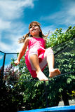 Jumping in the garden Royalty Free Stock Images
