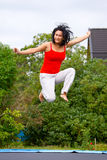 Jumping on garden trampoline Royalty Free Stock Photos