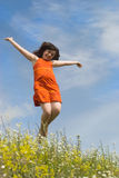 Jumping girl. On the green hill (summer Stock Photography