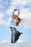 Jumping girl. Happy jumping girl in the sky stock images