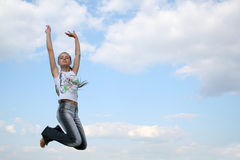 Jumping girl. Background of jumping girl on the sky stock photos