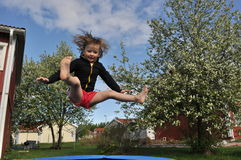 Jumping girl. Happy jumping girl on a blue sky background Stock Image