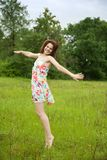 Jumping girl. Against summer meadow in summer day Royalty Free Stock Photos