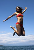 Jumping girl stock photos
