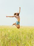 Jumping girl. At cereals field in summer Stock Photography